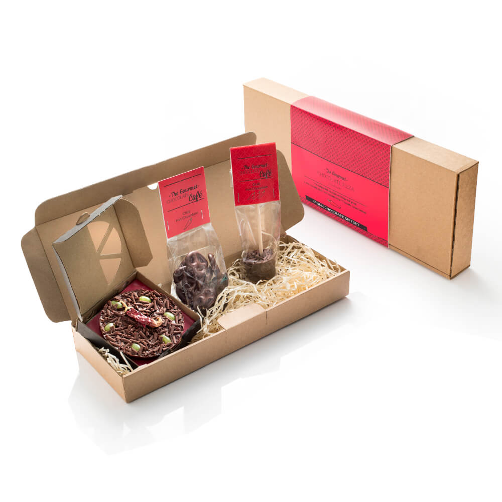 Our new Chilli Chocolate Gift Pack contains 1 x Mini Chilli Chocolate Pizza, 1 x Chilli Hot Chocolate Stick and 1 x  Bag of Chilli Chocolate Pretzels.